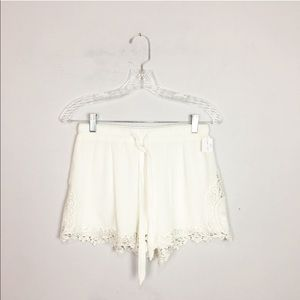 Urban Outfitters flowy lace trim shorts white S